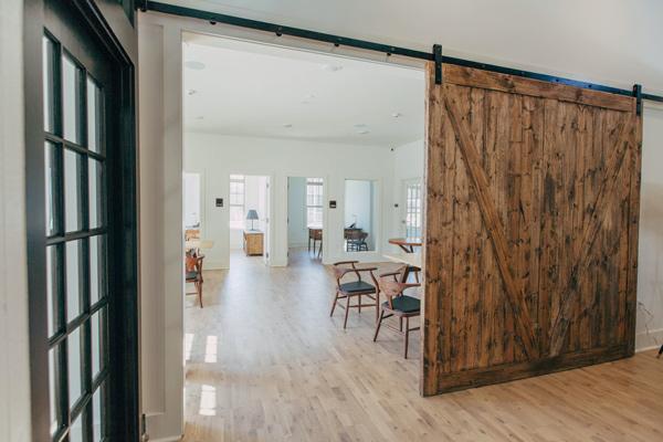 large reclaimed barn door in modern home